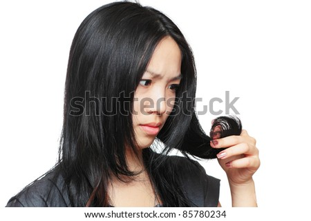 Young woman have hair problem - stock photo