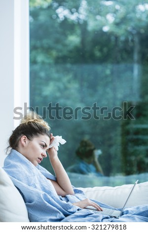 Young woman having a cold during autumn time - stock photo