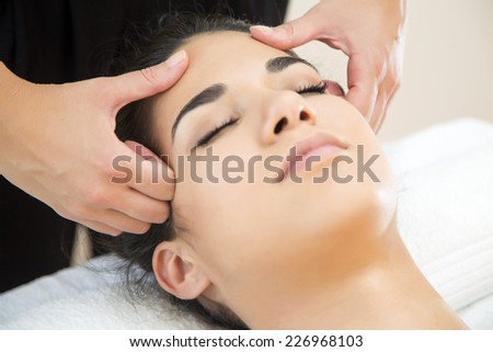 Young woman having a head massage