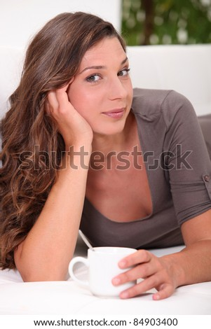 Young woman having a hot drink