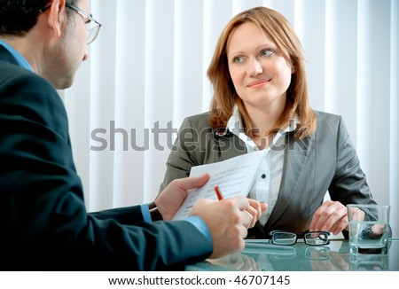 Young woman having a job interview in a  office