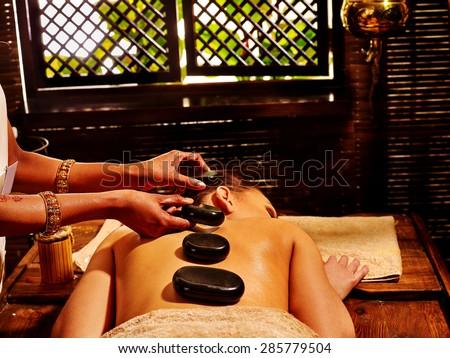 Young woman having Ayurveda stone massage. - stock photo