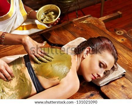 Young woman having body Ayurveda spa massage. - stock photo