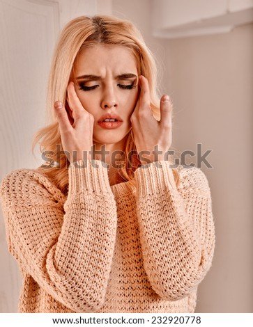 Young woman having  cold and high temperature. - stock photo