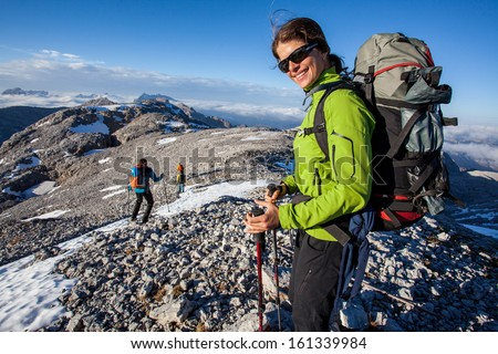 Young woman having fun during mountain hike - stock photo