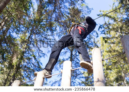 young woman having fun in an outdoor adventure park