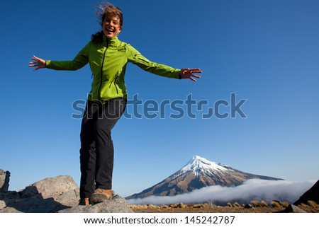 Young woman having fun in the mountains