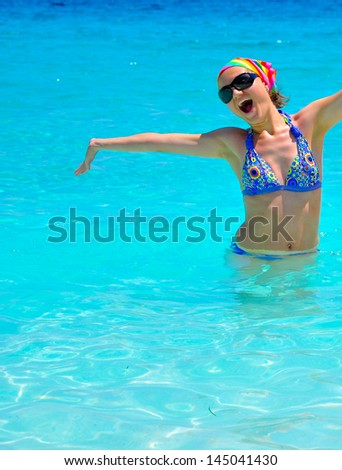 Young woman having fun in the sea - stock photo