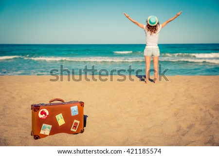 Young woman having fun on the beach. Summer vacation and travel concept - stock photo
