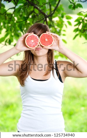 Young woman having fun with fruits - stock photo