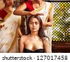 Young woman having head ayurveda spa treatment. - stock