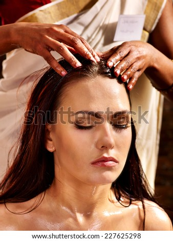 Young woman having head ayurveda spa treatment. - stock photo