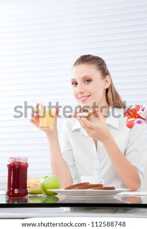 Young woman having healthy breakfast .