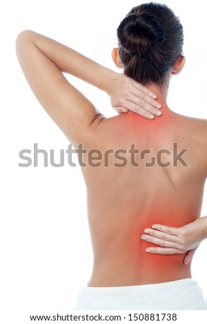 Young woman having neck and backache - stock photo