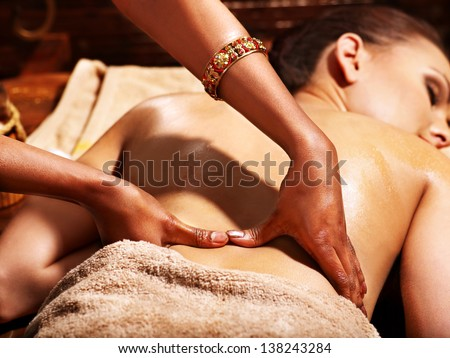 Young woman having oil Ayurveda spa treatment.