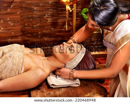 Young woman having oil Ayurveda spa treatment. - stock photo