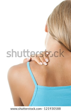 Young woman having pain in the back and neck,Pain in back - stock photo