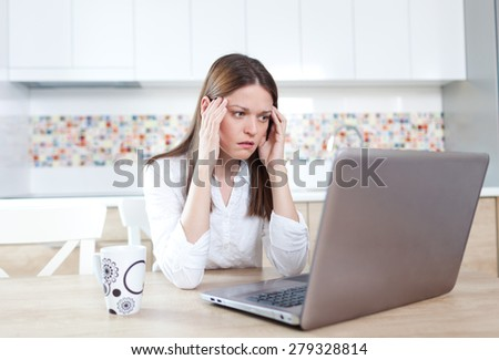 Young woman having trouble with laptop - stock photo