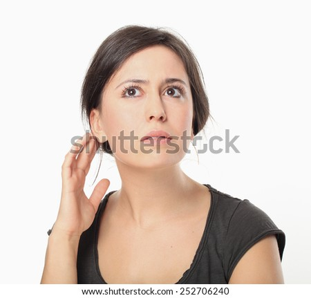 Young Woman Hear Something. - stock photo