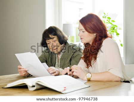 Young woman helping her Grandmother