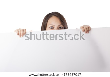 Young woman hiding behind a banner on white background