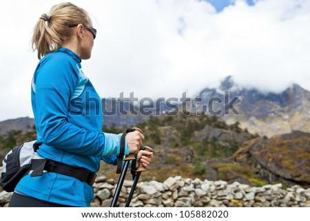 Young woman hiker hiking in Himalaya Mountains in Nepal - stock photo