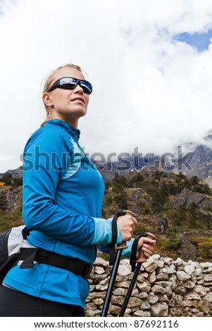 Young woman hiker hiking in mountains in Nepal