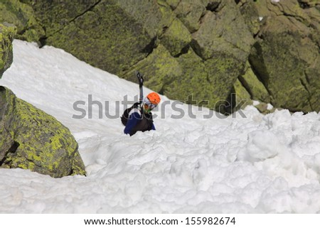 Young woman hikes on the glacier