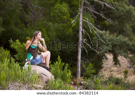 Young woman hiking at the forest
