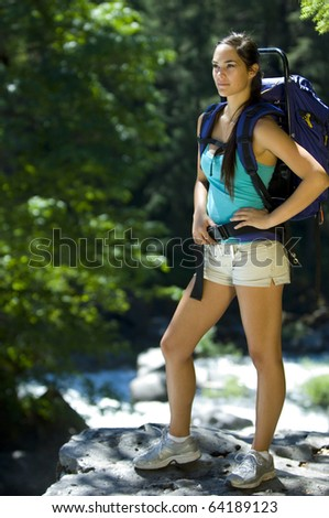 Young woman hiking in summer near Rogue River