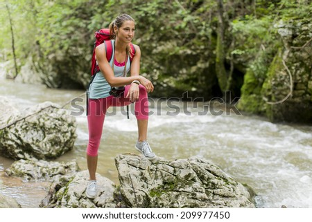 Young woman hiking in the forest - stock photo