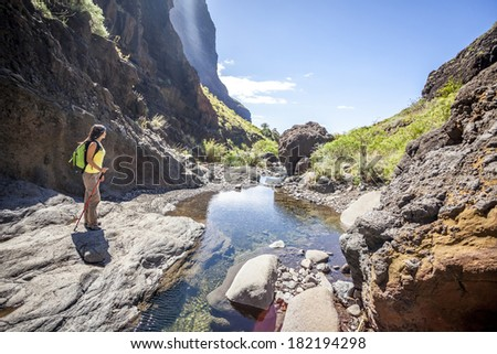 young woman hiking in tropical nature - stock photo
