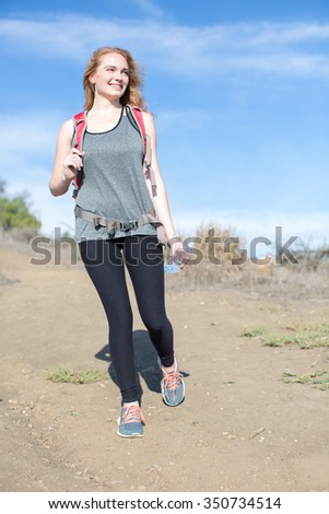Young woman hiking on a sunny day - stock photo