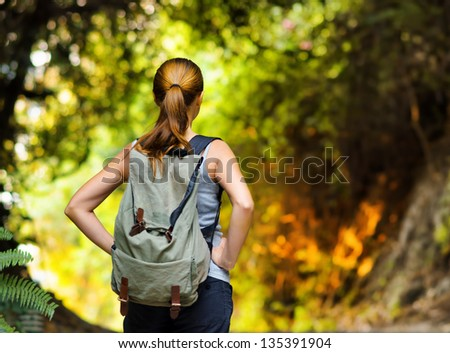 Young woman hiking with backpack.