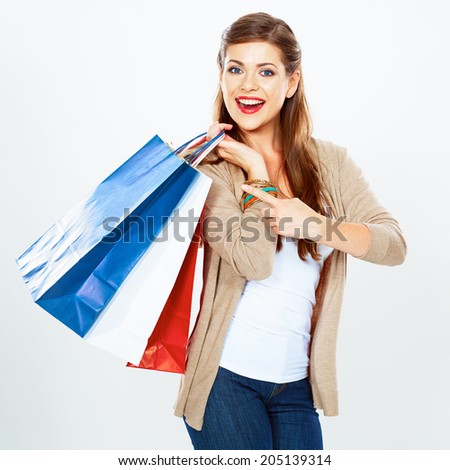 Young woman hold shopping bag. Isolated white background portrait.