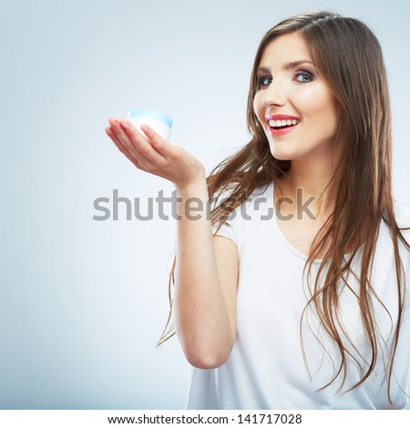 Young woman hold skin care cosmetic. Clean skin. Beauty female model isolated portrait. - stock photo