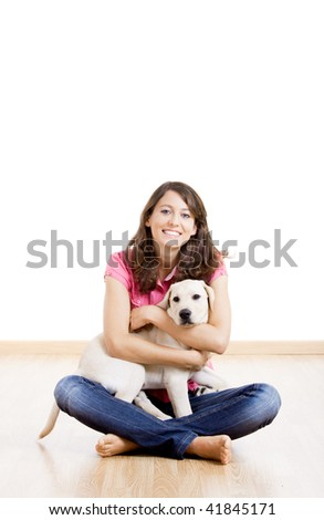 Young woman holding a beautiful and cute dog - stock photo