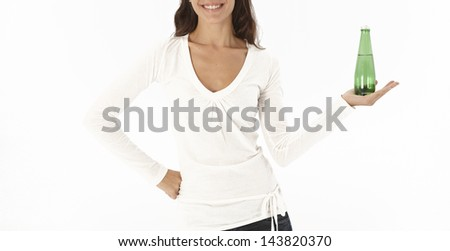 Young woman holding a bottle of water vertical against white background