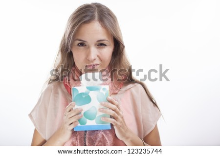Young woman holding a box of tissues and feeling unwell - stock photo