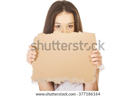 Young woman holding a cardboard. - stock photo