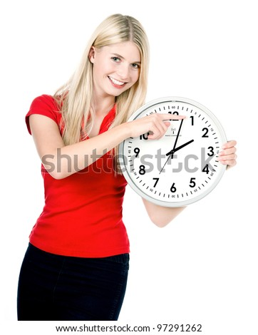 young woman holding a clock. time management concept. summer time (Daylight Saving Time) - stock photo