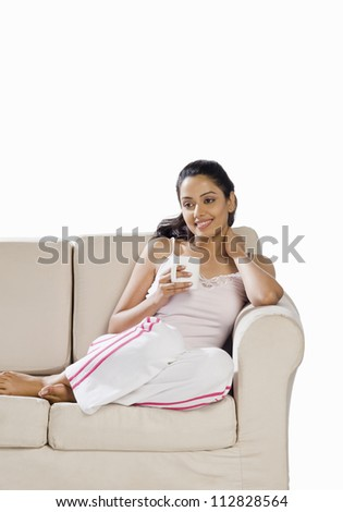 Young woman holding a coffee mug - stock photo