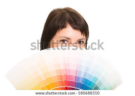 Young woman holding a color palette. Isolated white background. - stock photo