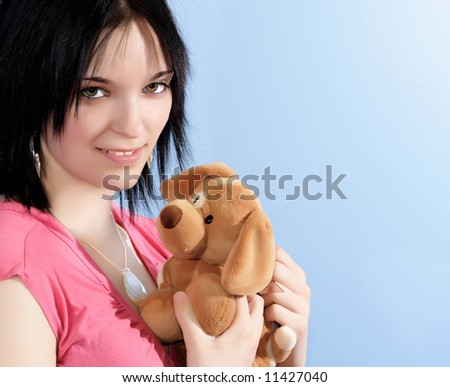 young woman holding a fluff animal