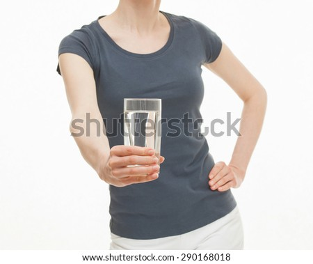 Young woman holding  a glass of water, white background