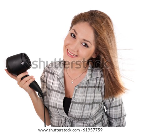 Young woman holding a hairdryer,isolated on white