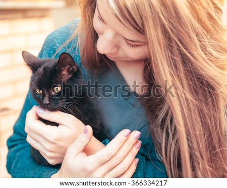 Young woman holding a kitten