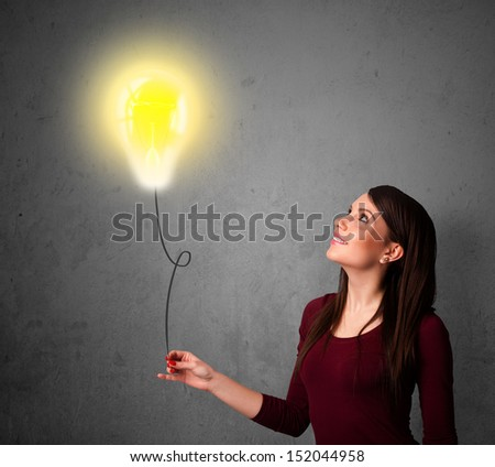 Young woman holding a lightbulb balloon