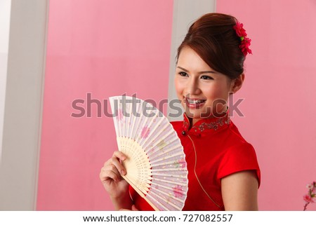 Young woman holding a  paper fan