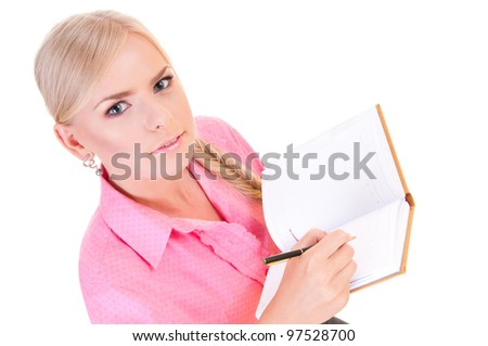 young woman holding a pen and a notebook in her hands